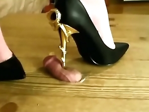 my new heels crushing the cum out of a slaves cock