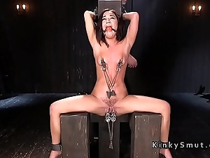 Brunette attendant gets nipples weighted