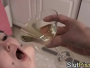 slave goth girl pissing in glass and then drinks her own piss