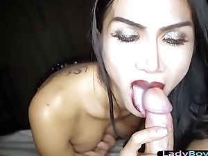 Asian transsexual gives a gentle handjob added to blowjob